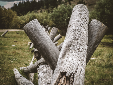 An old broken down fence in the middle of the field