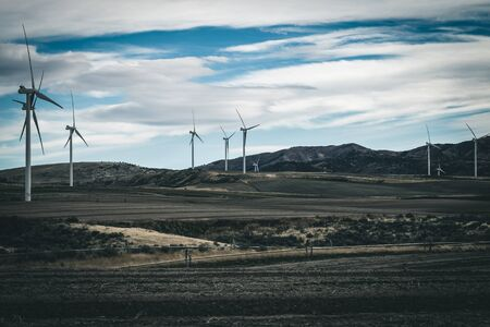 A wind turbine farm canvases the countryside, as cropland does double-duty producing green energy for Idaho. 写真素材 - 128434391