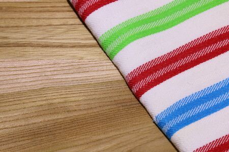 dishtowel: Photo of dishtowel tablecloth on wooden table with copyspace Stock Photo