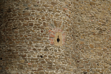 gothic build: Detail of medieval castle wall with small arrow slit window