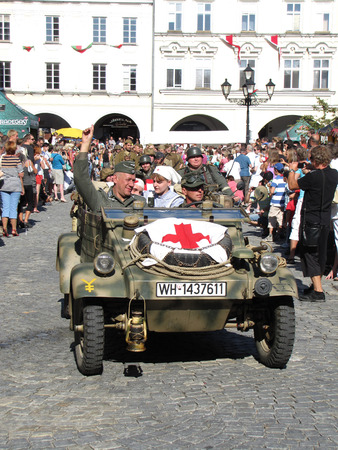 speedster: Novy Jicin, Czech Republic - September 5 2015: KDF 82 Kubelwagen (also VW 82, Type 82) with red cross (ambulance) on parade during annual city celebration of Novy Jicin, Czech Republic