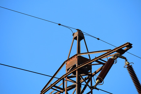 power tower: Detail of old transmission tower also power tower or electricity pylon taken during sunny day Stock Photo