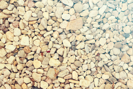 Light pabble stone wallpaper background with yellowish accent, summer rays like, retro look