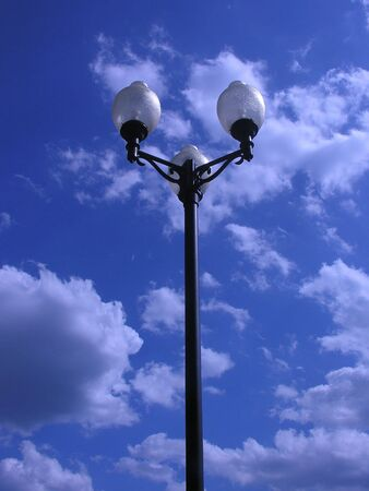 Lamp post touching the clouds gives new meaning to the words sky light