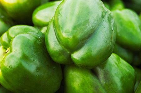 A closeup of a basket of green peppers Stock Photo