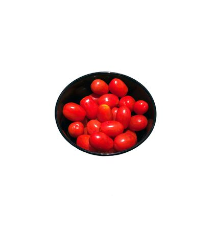 a bowl of bright red cherry tomatoes
