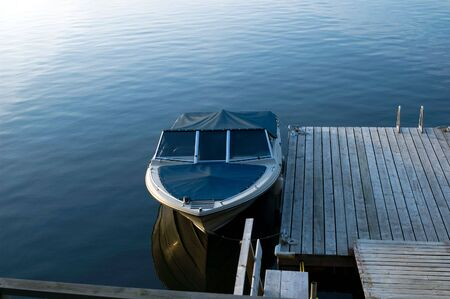 Boat on a quiet lake Stock Photo