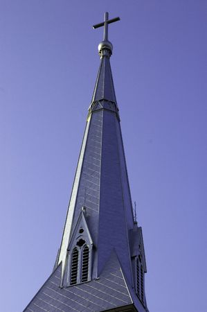 A church steeple, with a cross on top