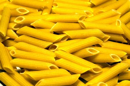 A small pile of penne pasta Stock Photo