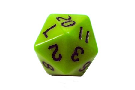 A lime colored twenty sided die for the game Dungeons and Dragons Stock Photo