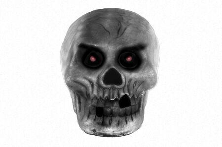 A dark, red eyed skull glares menacingly Stock Photo