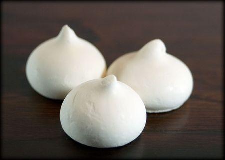 Three white vanilla cookies