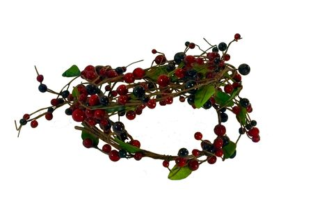 A wreath made of berries and leaves Stock Photo