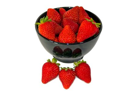 A bowl of bright red strawberries