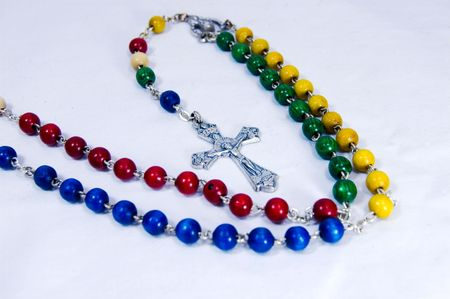 A rosary, with red, blue,yellow and green beads