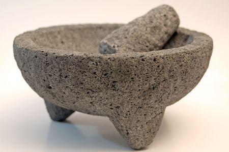 A heavy granite mortar and pestle