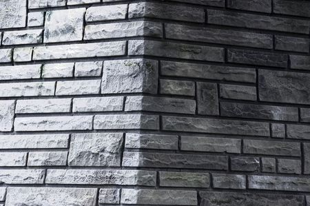 A gray brick structure, with a corner angle Stock Photo
