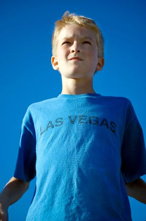 A young teen boy looks to the sky