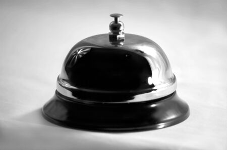 bellman: A grayscale photograph of a desk bell Stock Photo