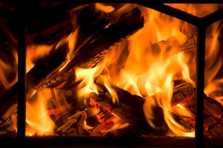Flames flicker in a fireplace, providing warmth for all Stock Photo