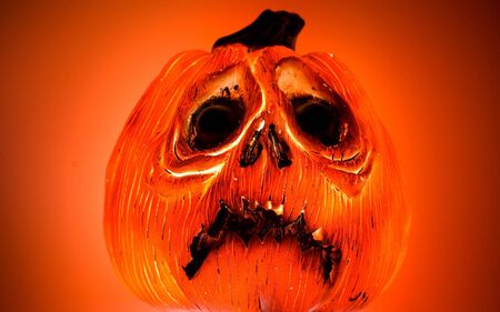 A glowing but frowning Jack O Lantern