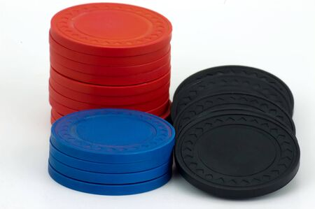 Red, blue and black poker chips