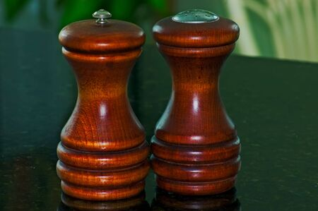 Two wooden salt and pepper mills Stock Photo