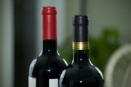 Two sealed bottles of wine