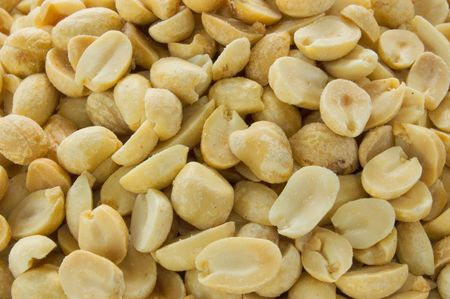 A macro shot of dry roasted peanuts