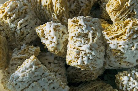 A macro shot of frosted wheat cereal
