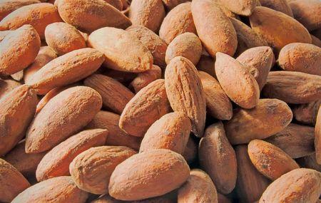 A closeup shot of a salted almonds Stock Photo