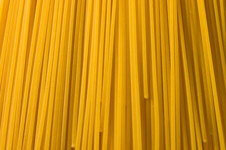 A close up shot of dry spaghetti