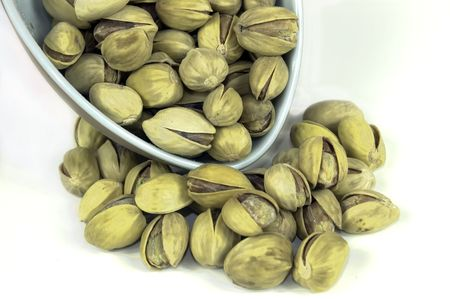 A scoopfull of white pistachio nuts