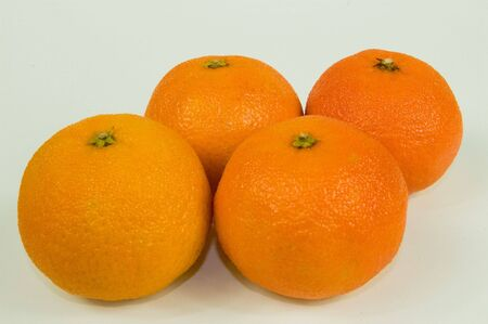 Four oranges isolated on a white background