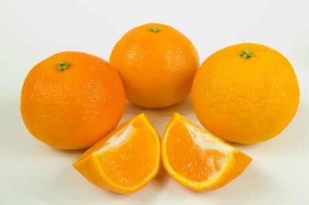 Three oranges and slices isolated on white