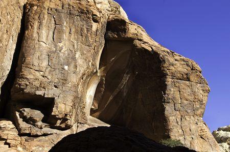 A rock facing has a sharp piece missing