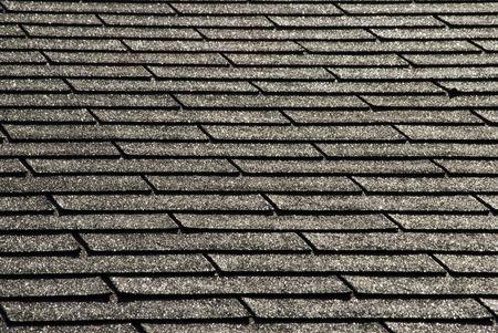 Black shingles shimmer after a summer rain