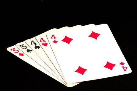 Poker Hand - Full House on black background