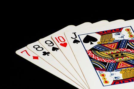 Poker Hand - Straight on black background