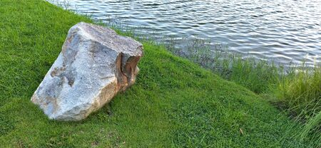 Big rock near water 写真素材