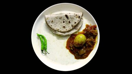 Roti with Egg curry and green chilli this is best lunch and dinner. This Indian dish chapati Naan made up of wheat flour