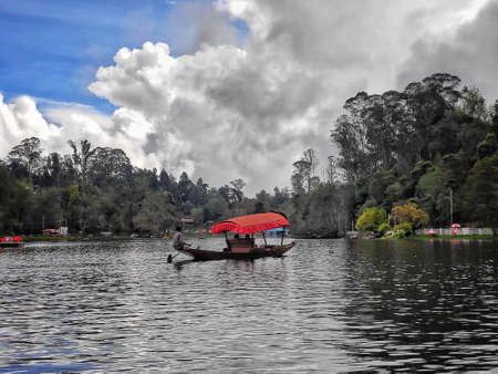 boating in a lake in pleasant nature