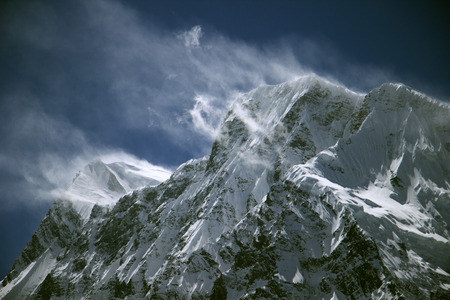 trecking: Blown snow on the summits of the Himalayas