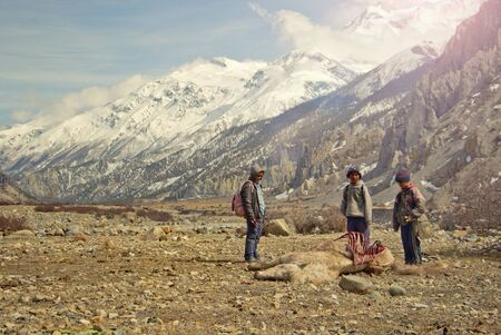three children: Three children with carrion in Nepal Editorial