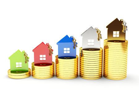 Hypotheek concept. Verschillende huizen op stapels munten op een witte achtergrond