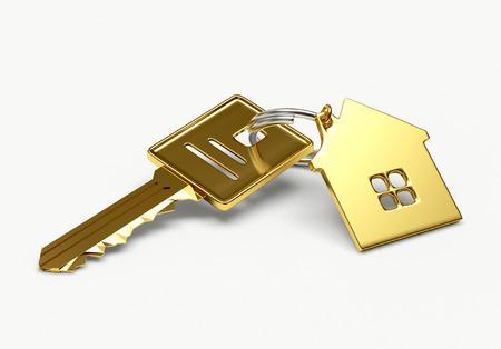 Hypotheek concept. Gouden sleutel met huis figuur op een witte achtergrond Stockfoto