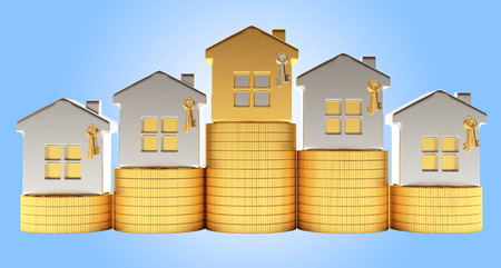 Silver and golden houses on stacks of coins on blue background