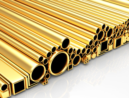 Round, square golden tubes and pipes of different diameters and shapes on a white