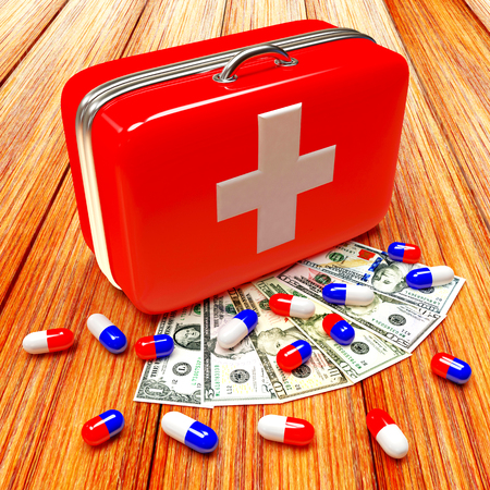 medical bills: First aid kit with medical capsule and dollar bills on wood background Stock Photo