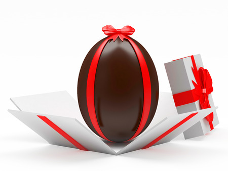 paschal: Chocolate Easter egg in an open gift box isolated on a white background